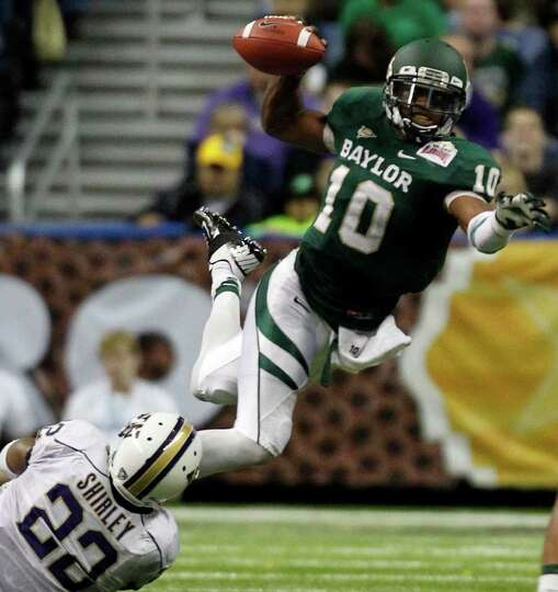 FOR SPORTS - Baylor's Robert Griffin III (10) is tackled before he can get a pass off by Washington'