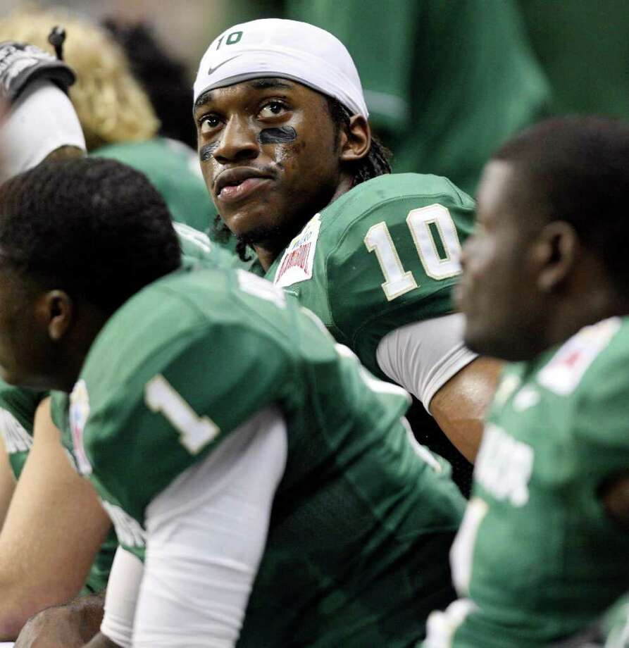 FOR SPORTS - Baylor's Robert Griffin III sits on the bench during first half action of the 2011 Valero Alamo Bowl against Washington Thursday Dec. 29, 2011 at the Alamodome in San Antonio,Tx.  (PHOTO BY EDWARD A. ORNELAS/eaornelas@express-news.net) Photo: EDWARD A. ORNELAS, SAN ANTONIO EXPRESS-NEWS / SAN ANTONIO EXPRESS-NEWS (NFS)