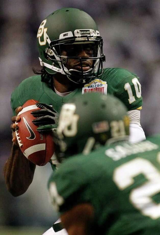 FOR SPORTS - Baylor's Robert Griffin III looks to pass during game action against Washington of the 2011 Valero Alamo Bowl at the Alamodome in San Antonio, Texas on Thursday, Dec. 29, 2011. MICHAEL MILLER / mmiller@express-news.net Photo: MICHAEL MILLER, SAN ANTONIO EXPRESS-NEWS / mmiller@express-news.net