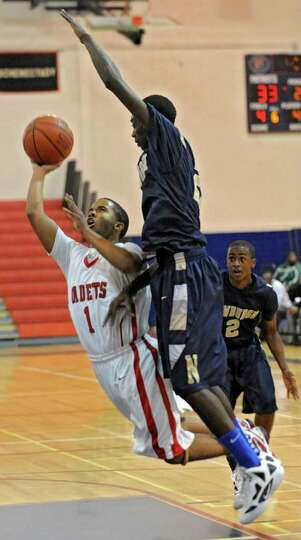 Darrien White of Albany Academy shoots the ball under Robert Mills of Newburgh Free Academy during t