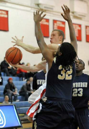 Matt LaClair of Albany Academy drives to the basket against Jonte Rutty of Newburgh Free Academy dur