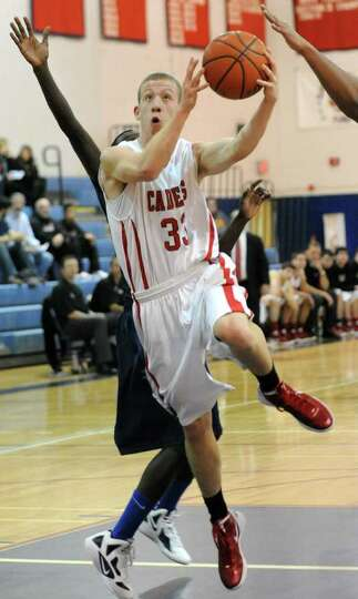 Matt LaClair of Albany Academy drives to the basket against Newburgh Free Academy during the Hilliar