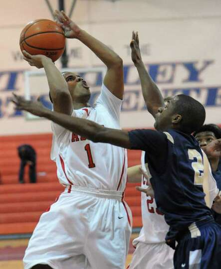 Darrien White of Albany Academy drives to the basket against Newburgh Free Academy during the Hillia