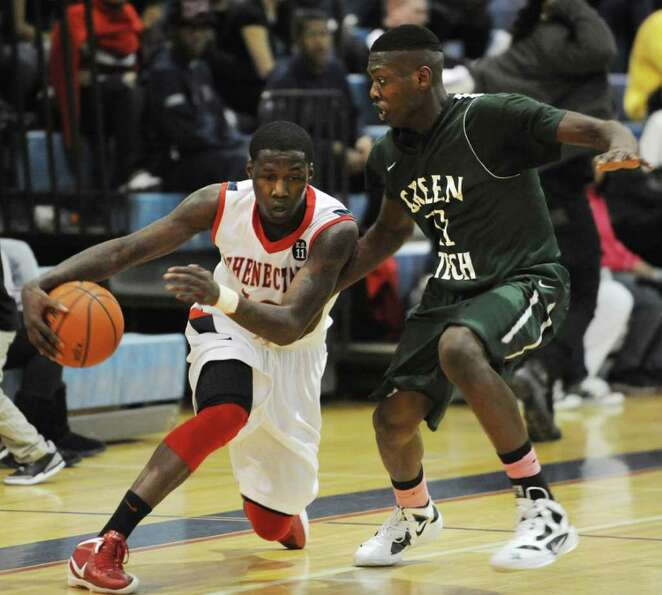 Jallah Tarver of Schenectady dribbles around Jafari Coleman of Green Tech during the Hilliard Basket