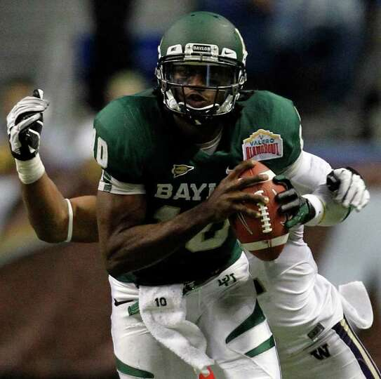 Baylor's Robert Griffin III is tackled from behind by Washington's Josh Shirley during game action o