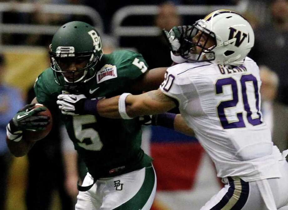 Baylor's Antwan Goodley (5) stiffarms Washington's Justin Glenn during game action of the Valero Alamo Bowl 2011 at the Alamodome in San Antonio, Texas on Thursday, Dec. 29, 2011. MICHAEL MILLER / mmiller@express-news.net Photo: MICHAEL MILLER, Express-News / mmiller@express-news.net