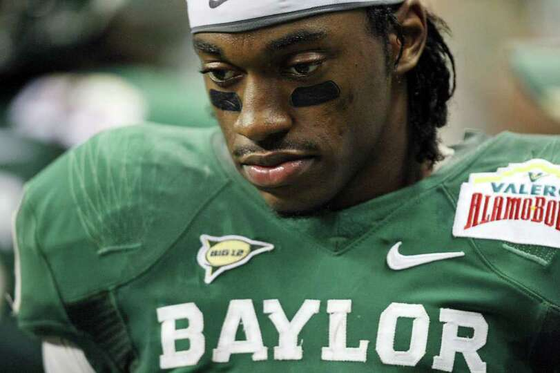 Baylor's Robert Griffin III  walks the sidelines during first half action of the Valero Alamo Bowl 2