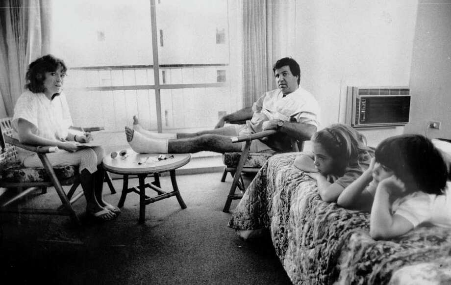 PUERTO RICO - JANUARY 01:  Survivors Joan and John Benevento, who injured his feet jumping through casino window, and Chandra, 10, and Brandon, 7, of Woodbridge, Conn., are together in hotel room after four hours of serparation during blaze that killed 95 at the Dupont Plaza Hotel..  (Photo by Misha Erwitt/NY Daily News Archive via Getty Images) Photo: New York Daily News Archive, NY Daily News Via Getty Images / 1987/Daily News, L.P. (New York)