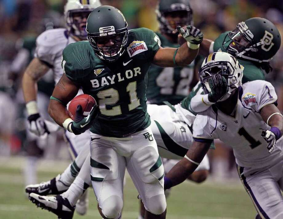 The Bears Jarred Salubi rolls for yardage in the first quarter as Baylor plays Washington in the Valero Alamo Bowl 2011 at the Alamodome in San Antonio, Texas  on December 29, 2011 Tom Reel/Staff Photo: TOM REEL, Express-News / © 2011 San Antonio Express-News