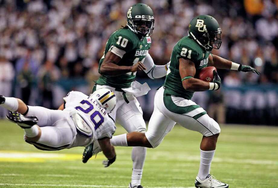 The Bears Jarred Salubi makes yardage in the first quarter as Baylor plays Washington in the Valero Alamo Bowl 2011 at the Alamodome in San Antonio, Texas  on December 29, 2011 Tom Reel/Staff Photo: TOM REEL, Express-News / © 2011 San Antonio Express-News