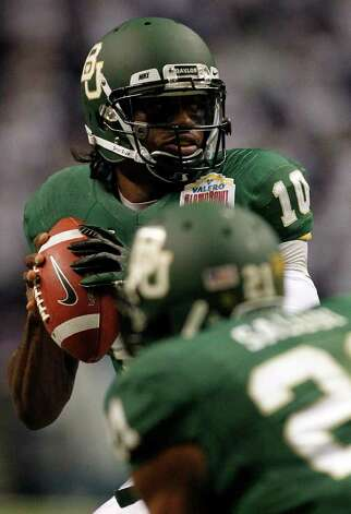 Baylor's Robert Griffin III looks to pass during game action against Washington of the  Valero Alamo Bowl 2011 at the Alamodome in San Antonio, Texas on Thursday, Dec. 29, 2011. MICHAEL MILLER / mmiller@express-news.net Photo: MICHAEL MILLER, Express-News / mmiller@express-news.net