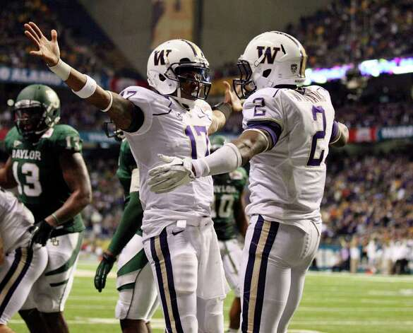 Washington's Keith Price celebrates with teammate Washington's Kasen Williams after scoring a touchdown against Baylor during second half action of the Valero Alamo Bowl 2011 on  Thursday Dec. 29, 2011 at the Alamodome in San Antonio,Tx. Photo: EDWARD A. ORNELAS, Express-News / SAN ANTONIO EXPRESS-NEWS (NFS)