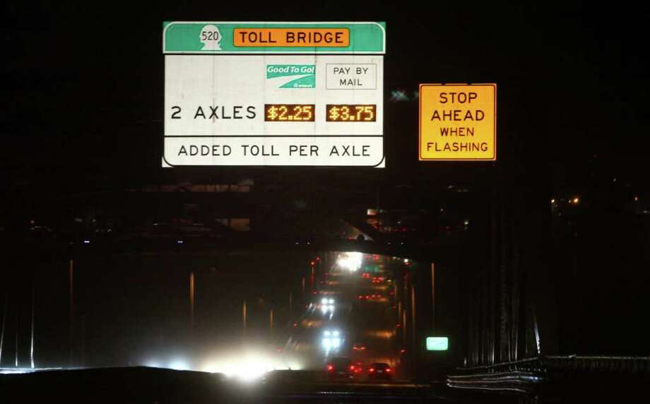 Cars are shown on the Higway 520 floating bridge during what normally is a jammed p.m. rush hour on Thursday, December 29, 2011. The highway saw its usual traffic cut nearly in half as tolling on the bridge began. Photo: JOSHUA TRUJILLO / SEATTLEPI.COM