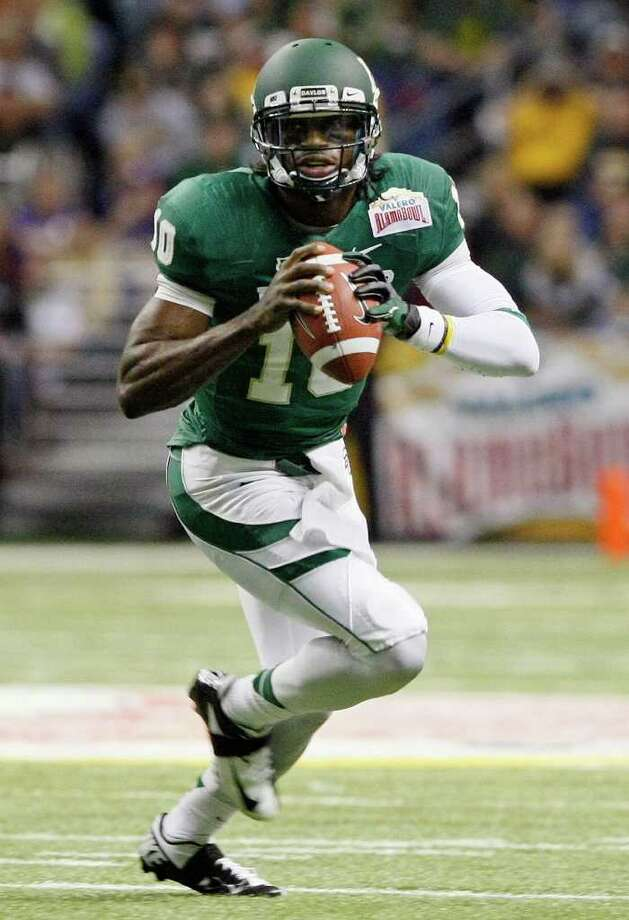Baylor quarterback Robert Griffin III looks to pass during the first half of the Alamo Bowl college football game against Washington, Thursday, Dec. 29, 2011, at the Alamodome in San Antonio. (AP Photo/Darren Abate) Photo: Darren Abate / FR115 AP