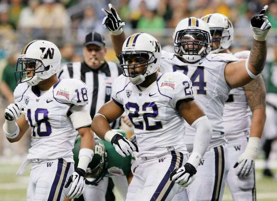 Washington's Josh Shirley, center, Gregory Ducre, left, and Alameda Ta'amu celebrate a sack during the first half of the Alamo Bowl college football game against Baylor, Thursday, Dec. 29, 2011, at the Alamodome in San Antonio. (AP Photo/Darren Abate) Photo: Darren Abate / FR115 AP