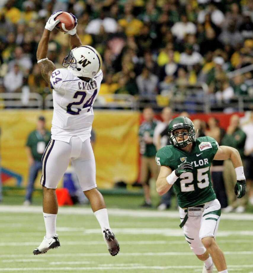 Washington's Jesse Callier makes a reception in front of Baylor's Sam Holl during the first half of the Alamo Bowl college football game, Thursday, Dec. 29, 2011, at the Alamodome in San Antonio. (AP Photo/Darren Abate) Photo: Darren Abate / FR115 AP