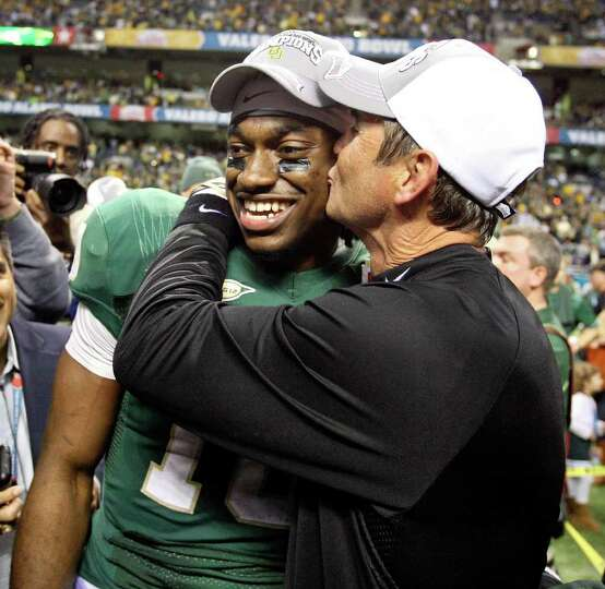 FOR SPORTS - Baylor's Robert Griffin III is kissed by Baylor head coach Art Briles after the 2011 Va