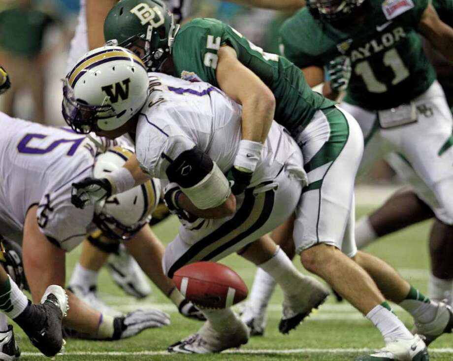 SPORTS  Baylors Sam Holl forces a fumble which stops a critical Washington drive late in the game as Baylor plays Washington in the Valero Alamo Bowl at the Alamodome in San Antonio, Texas  on December 29, 2011 Tom Reel/Staff Photo: TOM REEL, SAN ANTONIO EXPRESS-NEWS / © 2011 San Antonio Express-News