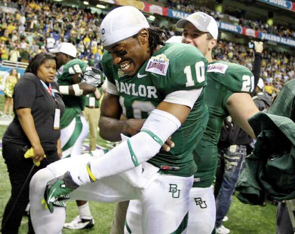 FOR SPORTS - Baylor's Robert Griffin III celebrates with teammate Baylor's Jerod Monk after the 2011 Valero Alamo Bowl with Washington Thursday Dec. 29, 2011 at the Alamodome in San Antonio,Tx. Baylor won 67-56. (PHOTO BY EDWARD A. ORNELAS/eaornelas@express-news.net) Photo: EDWARD A. ORNELAS, SAN ANTONIO EXPRESS-NEWS / SAN ANTONIO EXPRESS-NEWS (NFS)