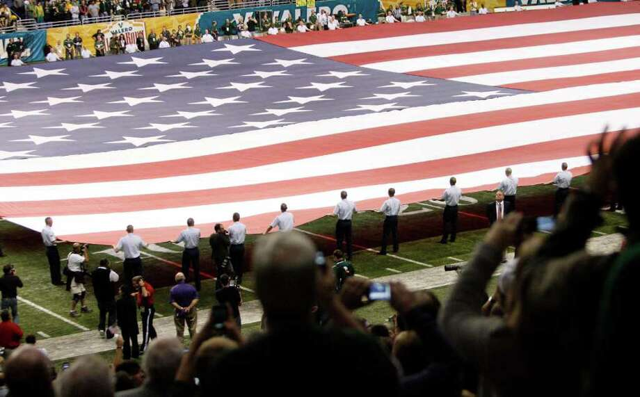 FOR SPORTS - The American flag is displayed on the field before game action between Baylor and Washington of the 2011 Valero Alamo Bowl at the Alamodome in San Antonio, Texas on Thursday, Dec. 29, 2011. MICHAEL MILLER / mmiller@express-news.net Photo: MICHAEL MILLER, SAN ANTONIO EXPRESS-NEWS / mmiller@express-news.net