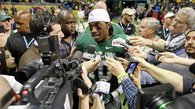 FOR SPORTS - Baylor's Robert Griffin III answers questions from the media after the 2011 Valero Alamo Bowl with Washington Thursday Dec. 29, 2011 at the Alamodome in San Antonio,Tx. Baylor won 67-56. (PHOTO BY EDWARD A. ORNELAS/eaornelas@express-news.net) Photo: EDWARD A. ORNELAS, SAN ANTONIO EXPRESS-NEWS / SAN ANTONIO EXPRESS-NEWS (NFS)