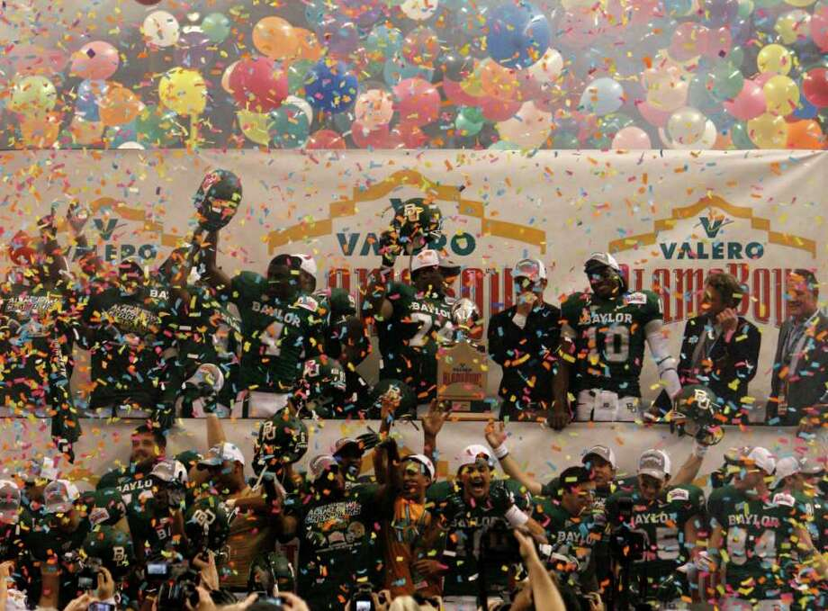 FOR SPORTS - The Baylor team celebrates after defeating Washington in the 2011 Valero Alamo Bowl at the Alamodome in San Antonio, Texas on Thursday, Dec. 29, 2011. Baylor won 67-56. MICHAEL MILLER / mmiller@express-news.net Photo: MICHAEL MILLER, SAN ANTONIO EXPRESS-NEWS / mmiller@express-news.net