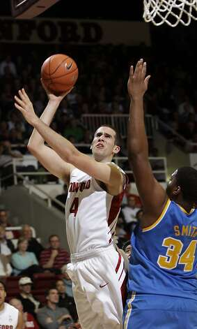 Stanford center Stefan Nastic (4) scores over UCLA center Joshua Smith (34) in the first half of an NCAA college basketball game in Stanford, Calif., Thursday, Dec. 29, 2011. Photo: Paul Sakuma, Associated Press