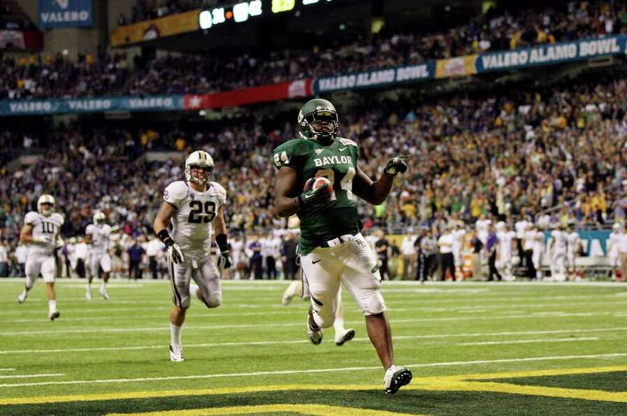 FOR SPORTS - Baylor's Terrance Ganaway scores a touchdown against Washington during second half acti
