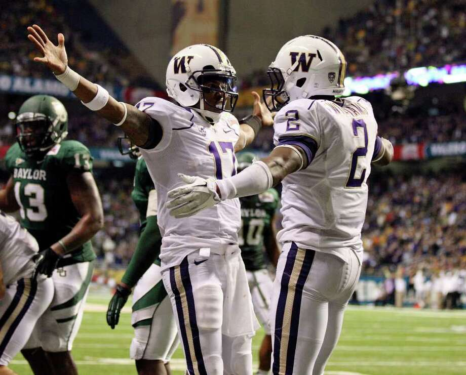 FOR SPORTS - Washington's Keith Price celebrates with teammate Washington's Kasen Williams after scoring a touchdown against Baylor during second half action of the 2011 Valero Alamo Bowl Thursday Dec. 29, 2011 at the Alamodome in San Antonio,Tx.  (PHOTO BY EDWARD A. ORNELAS/eaornelas@express-news.net) Photo: EDWARD A. ORNELAS, SAN ANTONIO EXPRESS-NEWS / SAN ANTONIO EXPRESS-NEWS (NFS)