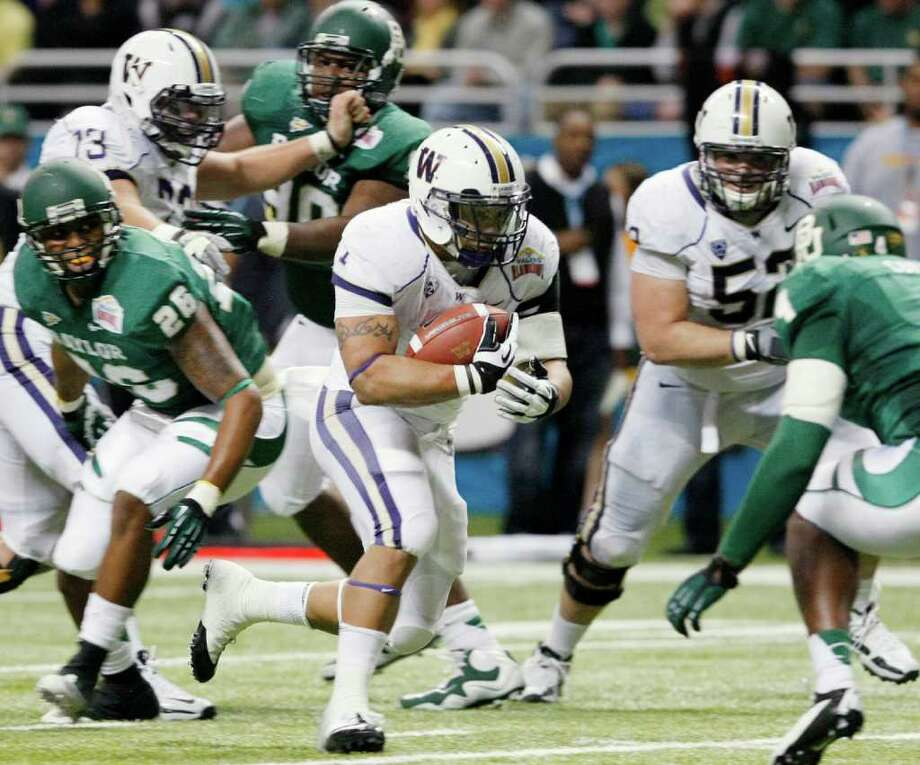 Washington's Chris Polk, center, rushes during the first half of the Alamo Bowl college football game against Baylor, Thursday, Dec. 29, 2011, at the Alamodome in San Antonio. (AP Photo/Darren Abate) Photo: Darren Abate, Associated Press / FR115 AP