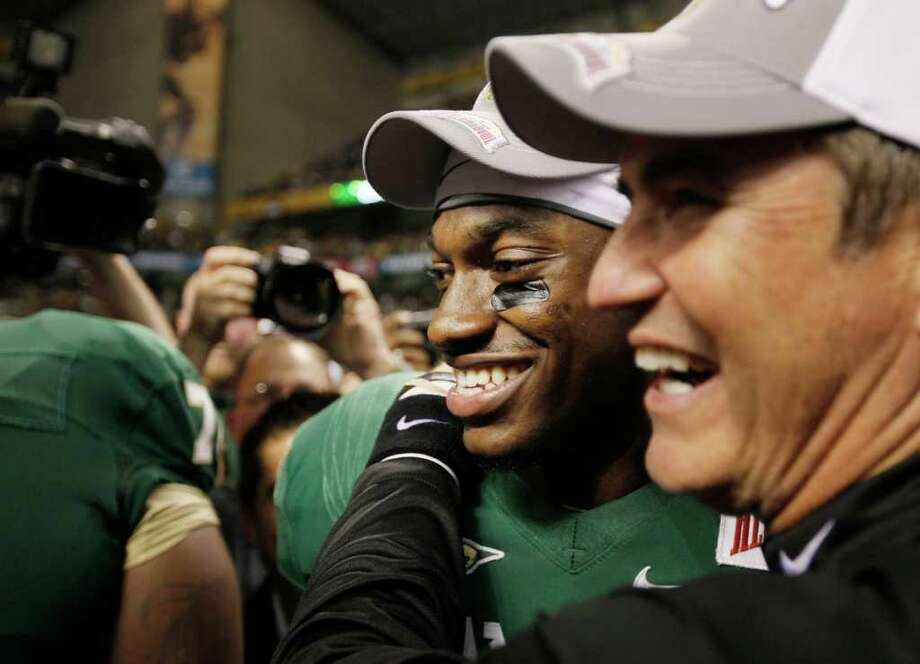 Baylor quarterback Robert Griffin III, left, celebrates with Baylor head coach Art Briles after the Alamo Bowl college football game, Thursday, Dec. 29, 2011, at the Alamodome in San Antonio. Baylor pulled out a thrilling Alamo Bowl victory in the highest-scoring bowl game in history, beating Washington 67-56 in a record-smashing shootout Thursday night. (AP Photo/Darren Abate) Photo: Darren Abate, Associated Press / FR115 AP
