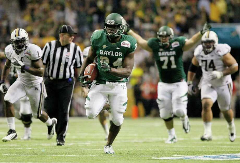 Dec. 29: Baylor 67, Washington 56 — Baylor's Terrance Ganaway rushes for a touchdown during the second half of Thursday's Alamo Bowl at the Alamodome in San Antonio. Ganaway rushed for 200 yards and five touchdowns to help Baylor pull out a thrilling victory in the highest-scoring bowl game in history. Photo: Darren Abate, Associated Press / FR115 AP