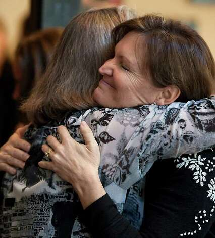 Deanne Breedlove, right, embraces a friend following a memorial service for her son, Ben Breedlove, who died on Christmas Day, at Gateway Church, in Austin on Thursday, Dec. 29, 2011. According to the Austin American Statesman, Breedlove, who was 18 when he succumbed to a lifelong heart condition, loved making funny videos and had his own channel on YouTube. His loved ones found his final video message hours after he had an apparent cardiac arrest at home. In it, Breedlove talks about cheating death three times and describes a vision that he had when his heart stopped earlier this month and his desire to stay in that peaceful place. Photo: Rodolfo Gonzalez, AP Photo/Austin American-Statesman