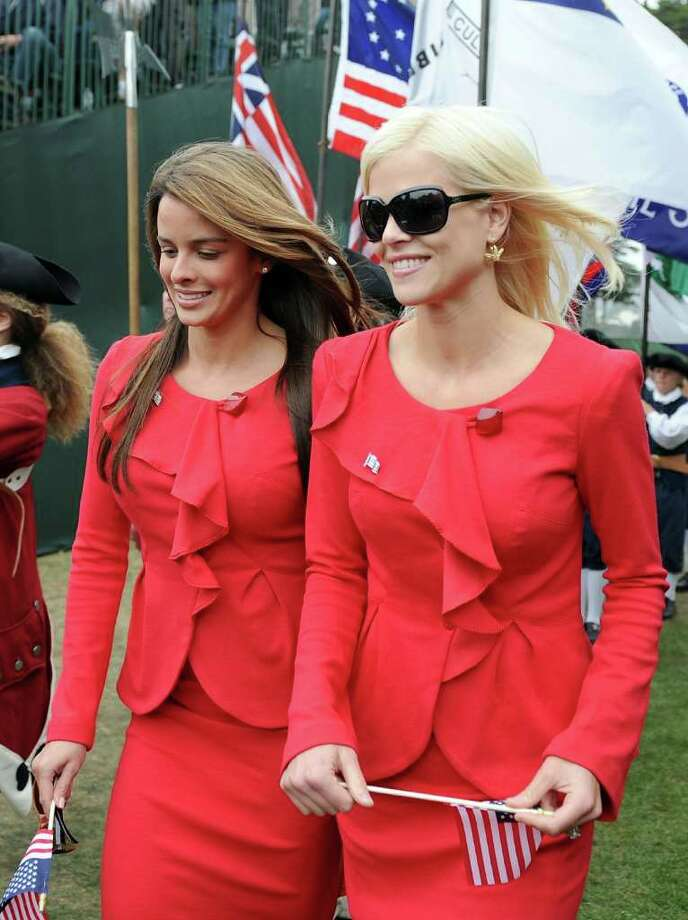 Elin Woods and Yvette Prieto make their way to their seats during Opening Ceremony of The Presidents Cup at Harding Park Golf Course on October 7, 2009 in San Francisco, California. Photo: Harry How, Getty Images / 2009 Getty Images