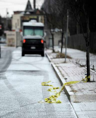 Police line tape is all that remains of a late evening shooting that involved a police officer on South Pearl Street between Second and Third Avenues in Albany, N.Y. Dec. 30, 2011.   One person is dead as a result of the shooting.    (Skip Dickstein / Times Union) Photo: SKIP DICKSTEIN / 2011