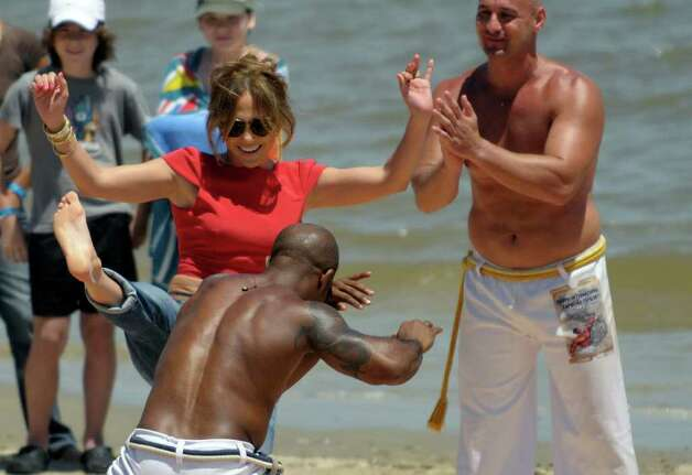 "Actress and singer Jennifer Lopez dances a traditional dance called ""capoeira"" during a filming of the reality show ""Q´Viva! The Chosen"" on the beach in Montevideo, Uruguay,Thursday Dec. 8, 2011. Photo: AP"