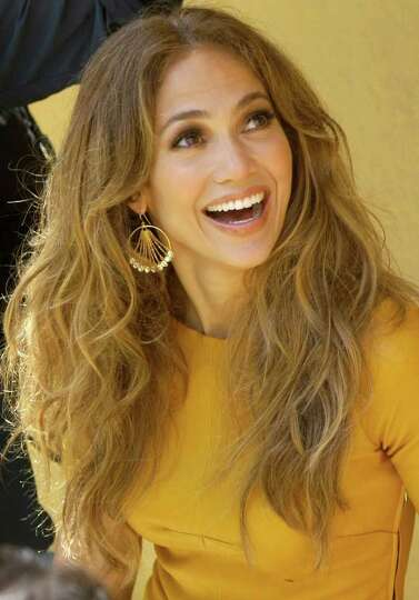 U.S. singer and actress Jennifer Lopez smiles toward fans during a recording in Lima, Peru, Saturday