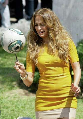 "U.S. singer and actress Jennifer Lopez spins a soccer ball on a pen during a recording in Lima, Peru, Saturday Dec. 3, 2011. Lopez is in Peru to record some episodes of the reality show ""Q'Viva! The Chosen."" Photo: AP"