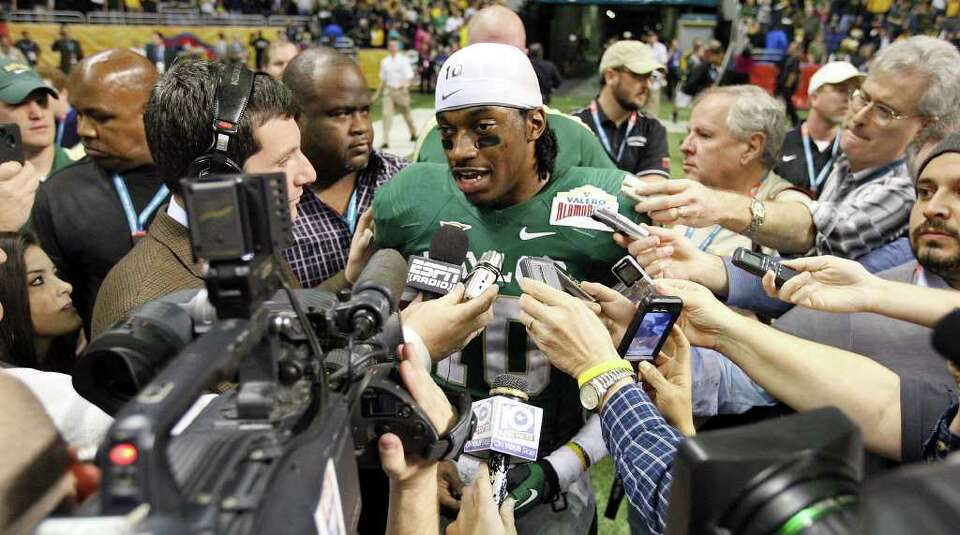 FOR SPORTS - Baylor's Robert Griffin III answers questions from the media after the 2011 Valero Alam