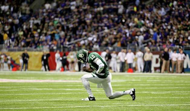 FOR SPORTS - Baylor's Robert Griffin III pauses after the his team scored a touchdown against Washington during second half action of the 2011 Valero Alamo Bowl Thursday Dec. 29, 2011 at the Alamodome in San Antonio,Tx.  (PHOTO BY EDWARD A. ORNELAS/eaornelas@express-news.net) Photo: EDWARD A. ORNELAS, SAN ANTONIO EXPRESS-NEWS / SAN ANTONIO EXPRESS-NEWS (NFS)