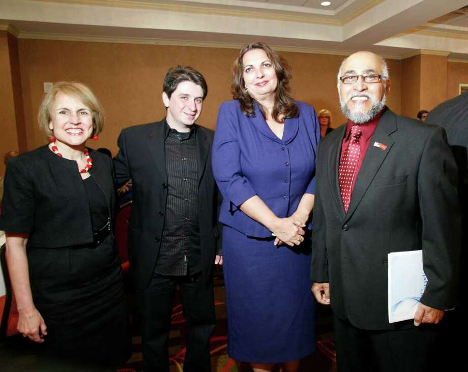 Abdur-Rahim Muhammad (far right) says all religions can work together —  and will. Here he is shown at the Muslim American Society of San Antonio's 2nd Annual Civic Iftar.  Photo: Express-News, File Photo / THE SAN ANTONIO EXPRESS-NEWS