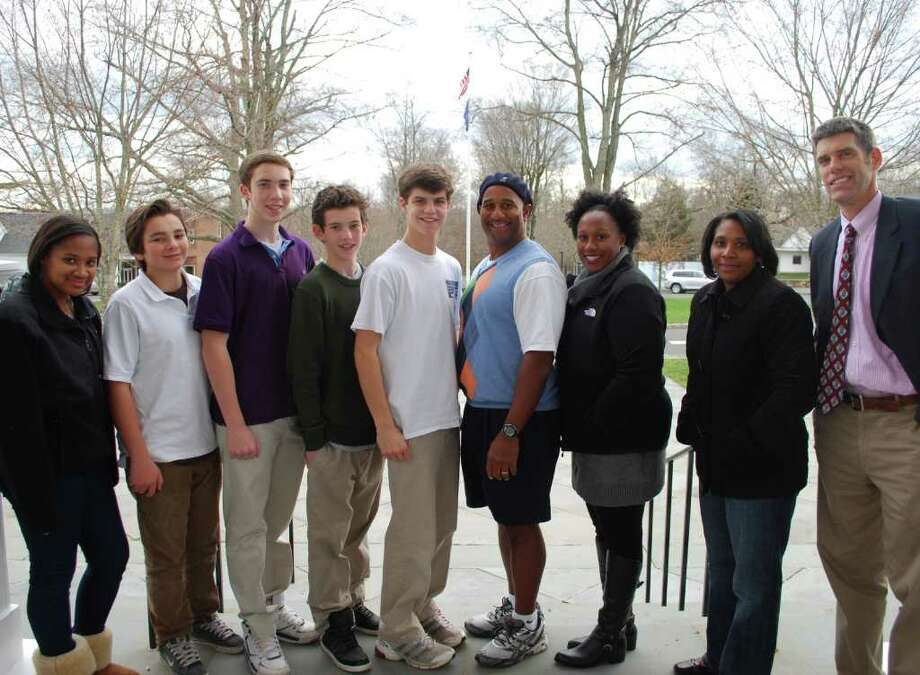 New Canaan Country School students and faculty attend diversity conference, from left, Brianna Cummings (Stamford); Parker Beladino (New Canaan); Kevin Pendo (Darien); James Maguire (Darien); and CJ York (Norwalk); along with coach Carl Broadnax, placement director; Nicole Victor, first grade teacher Mollie Kirkland; and upper school head Tim Delehaunty. Photo: Contributed Photo