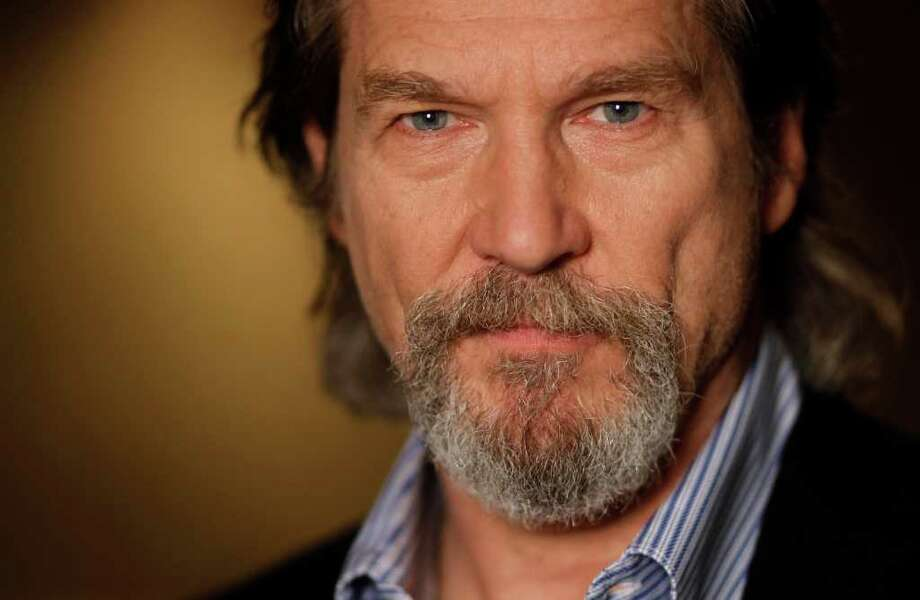 Jeff Bridges, who is known to many as the Dude in The Big Lebowski, won an Oscar for his work as country singer Bad Blake in Crazy Heart. He is the winner of the Houston Film Critics Society's 2011 lifetime achievement award. Photo: Matt Sayles / AP