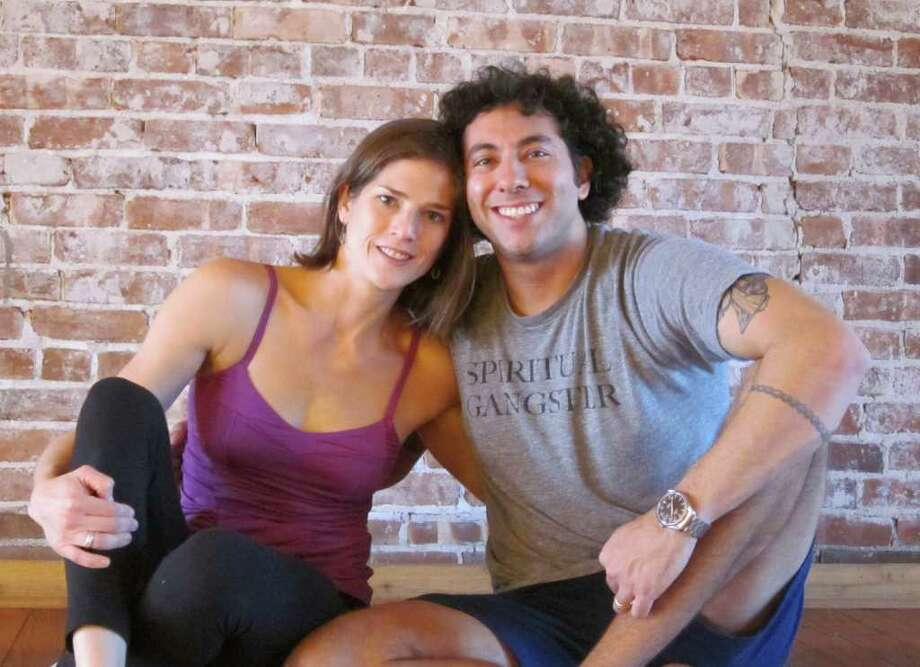 """Sarah McGrath of Norwalk and Mitchel Bleier of Westport will perform an intricately choreographed yoga demonstration during """"Demo for Dollars: Auction for Action,"""" which will benefit the Africa Yoga Project. Photo: Contributed Photo"""