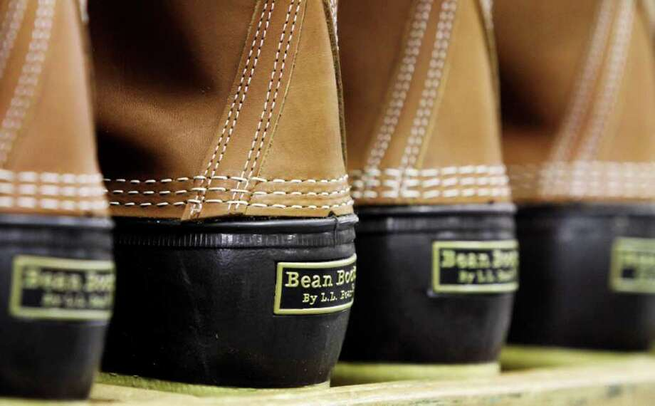 In this Dec. 14,  2011 photo, pairs of  boots are seen in the facility where L.L. Bean boots are assembled in Brunswick, Maine. L.L. Bean's famed hunting boots are seeing a surge in popularity, necessitating the hiring of more than 100 additional employees to make them.  (AP Photo/Pat Wellenbach) Photo: Pat Wellenbach / AP