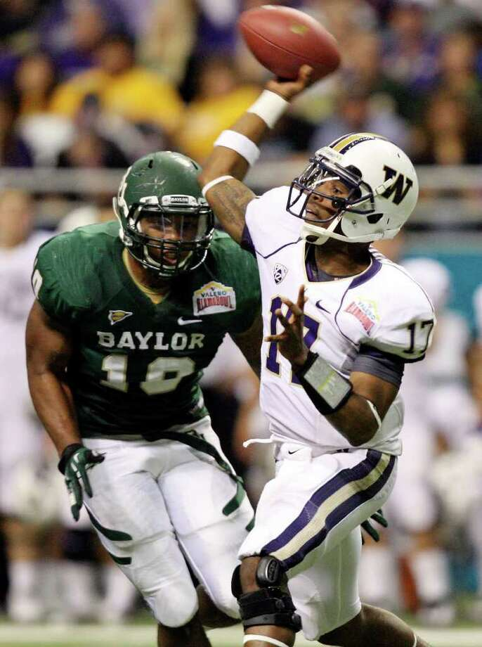 FOR SPORTS - Washington's Keith Price passes under pressure from Baylor's Gary Mason Jr. during second half action of the 2011 Valero Alamo Bowl Thursday Dec. 29, 2011 at the Alamodome in San Antonio,Tx.  (PHOTO BY EDWARD A. ORNELAS/eaornelas@express-news.net) Photo: EDWARD A. ORNELAS, SAN ANTONIO EXPRESS-NEWS / SAN ANTONIO EXPRESS-NEWS (NFS)