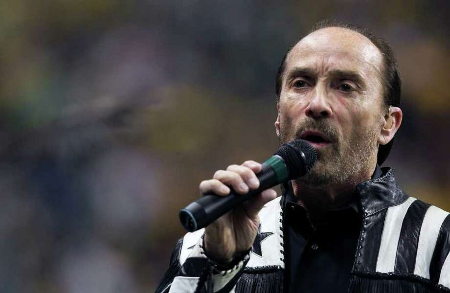 SPORTS  Lee Greenwood sings before the game as Baylor plays Washington in the Valero Alamo Bowl at the Alamodome in San Antonio, Texas  on December 29, 2011 Tom Reel/Staff Photo: TOM REEL, SAN ANTONIO EXPRESS-NEWS / © 2011 San Antonio Express-News