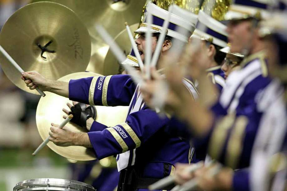 SPORTS  The Huskie band charges onto the field as Baylor plays Washington in the Valero Alamo Bowl at the Alamodome in San Antonio, Texas  on December 29, 2011 Tom Reel/Staff Photo: TOM REEL, SAN ANTONIO EXPRESS-NEWS / © 2011 San Antonio Express-News