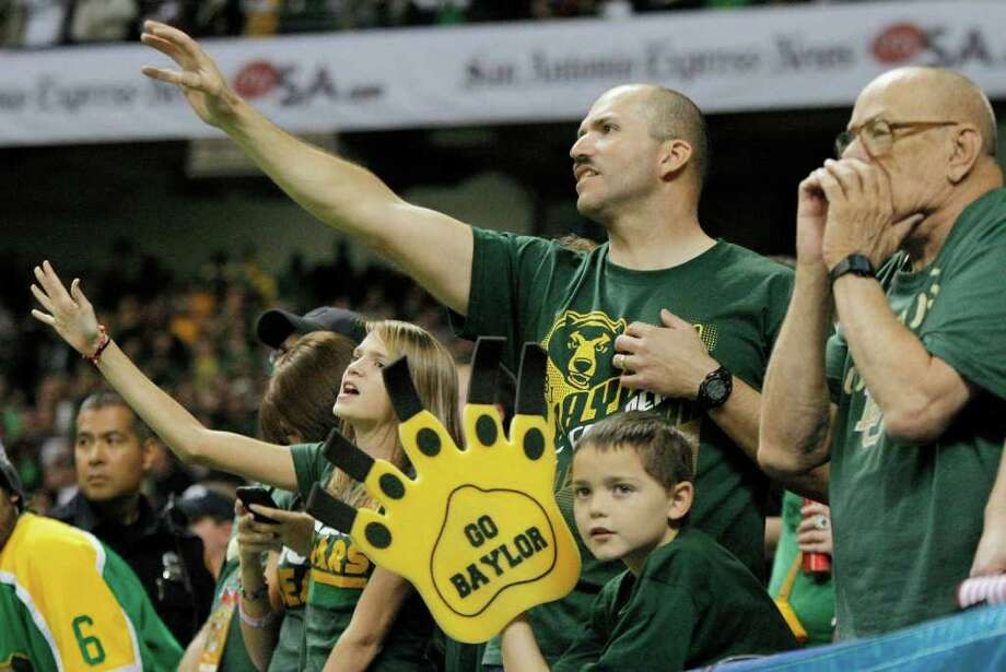 Baylor fans cheer during the second half of the Alamo Bowl college football game against Washington, Thursday, Dec. 29, 2011, at the Alamodome in San Antonio. Baylor pulled out a thrilling Alamo Bowl victory in the highest-scoring bowl game in history, beating Washington 67-56 in a record-smashing shootout Thursday night. Photo: AP