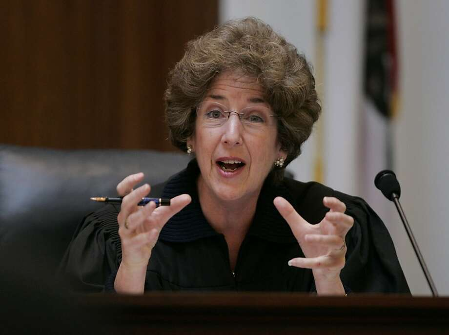 California Supreme Court Associate Justice Carol A. Corrigan gestures towards a presenter in San Francisco, Tuesday, March 4, 2008. Gay marriage supporters and opponents finished presenting arguments on whether California should join Massachusetts in legalizing same-sex marriages. The court heard more than 3 hours of arguments Tuesday in six separate cases being heard jointly. The seven justices asked whether California already protects the civil rights of gay and lesbian couples through domestic partnerships. (AP Photo/Paul Sakuma, pool) Photo: Paul Sakuma, AP 2008